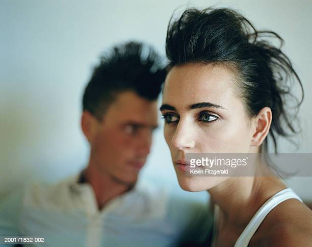 young couple, close-up (focus on woman) - backcombed stock photos and pictures