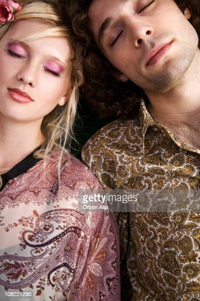 Young Couple Closing Eyes and Leaning on Each Other