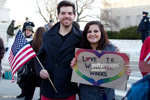Young couple comes out to support gay marriage during the DOMA and Prop 8 hearing at the Supreme Court in March 2013.