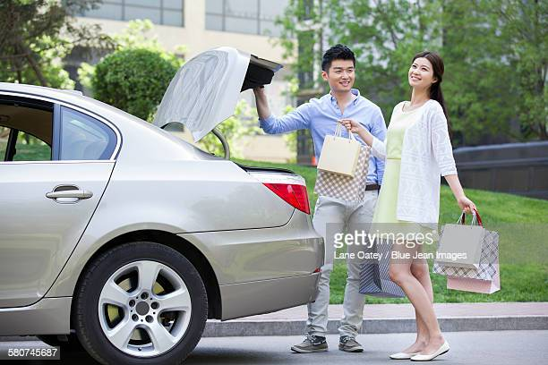 Young couple coming back from shopping