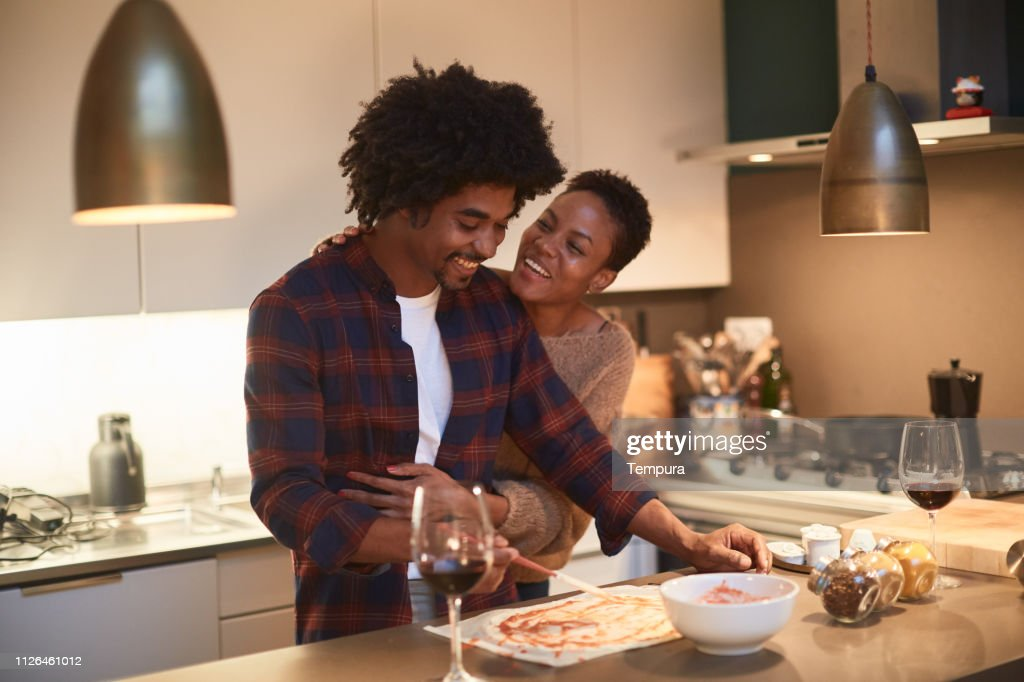Young couple cooking at home and celebrating Saint Valentine : Stock Photo