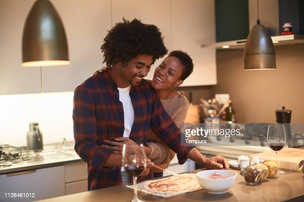 young couple cooking at home and celebrating saint valentine - valentine's day holiday stock pictures, royalty-free photos & images