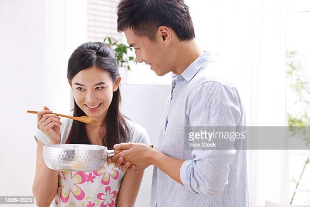 Young couple cooking in kitchen