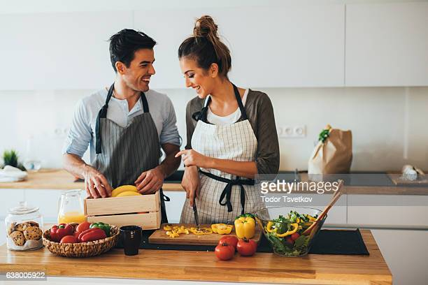 Young couple cooking in the kitchen
