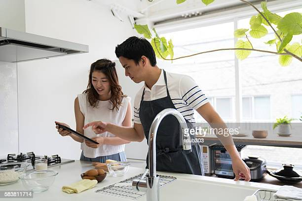Young couple cooking together in a modern kitchen