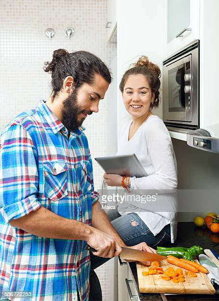 Young couple cooking with internet recipe