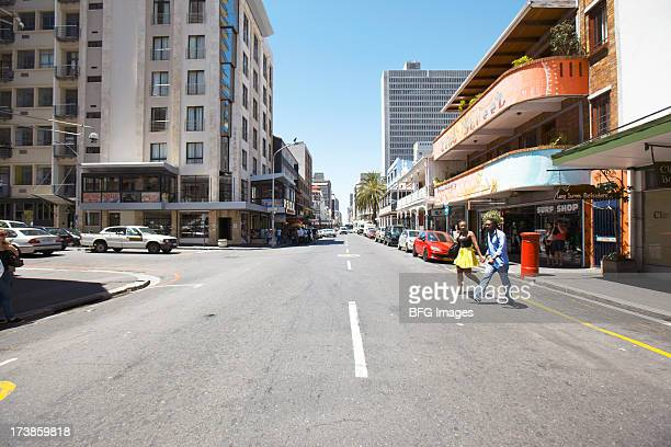 young couple crossing a street in cape town, western province, south africa - ケープタウン ストックフォトと画像