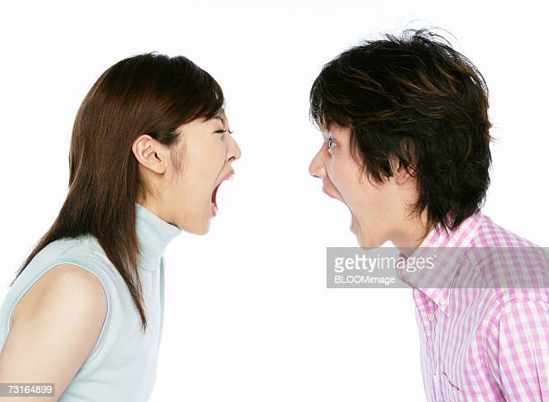 Young couple crying each other