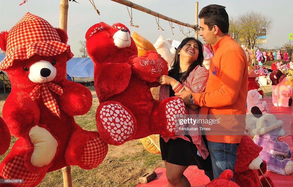A young couple cuddling with a soft toy on the outskirts of Chandigarh as they celebrated Valentine`s Day on February 14 2015 in Chandigarh India...