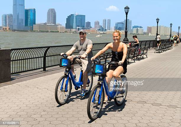 Young couple cycling with citi bike