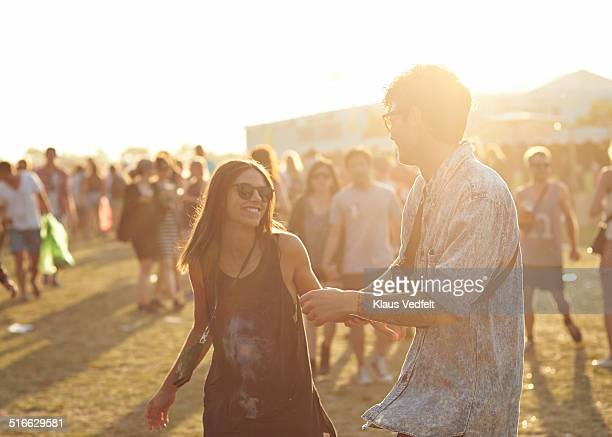 Young couple dancing at outside festival
