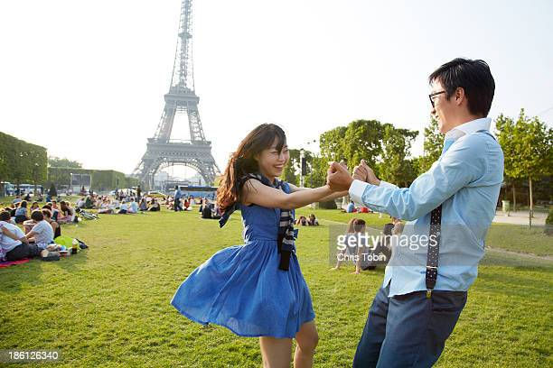 Young couple dancing at the Eiffel Tower