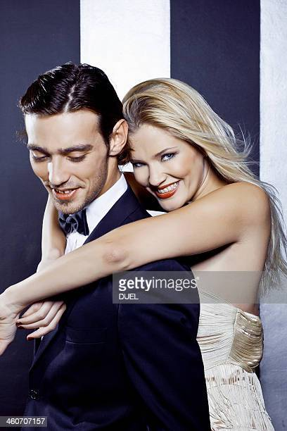 Young couple dancing closely in nightclub