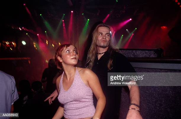 young couple dancing in a club - clubkleding stockfoto's en -beelden