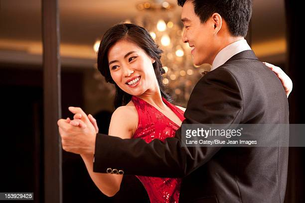 young couple dancing in a luxurious room - 舞踏会 ストックフォトと画像