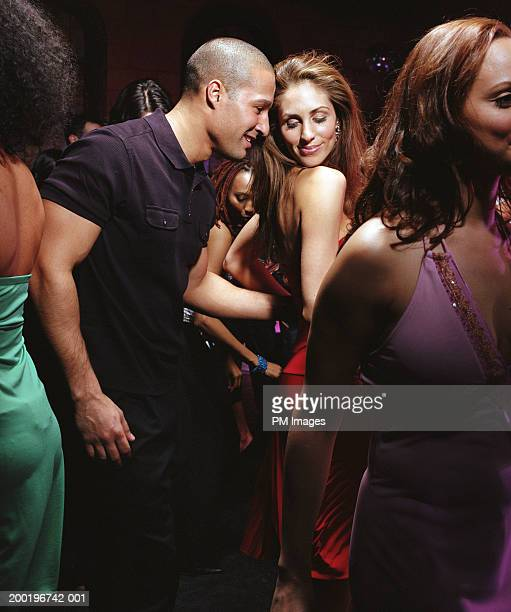 Young couple dancing in nightclub