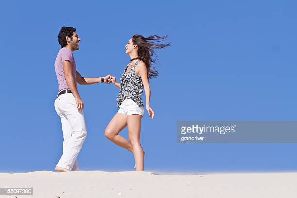 Young  Couple Dancing on Sand