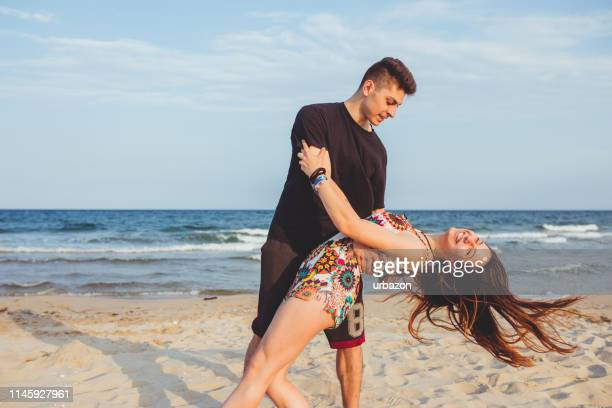 young couple dancing on the beach - rumba stock photos and pictures