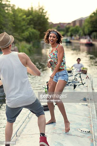 Young couple dancing on top of a canal boat