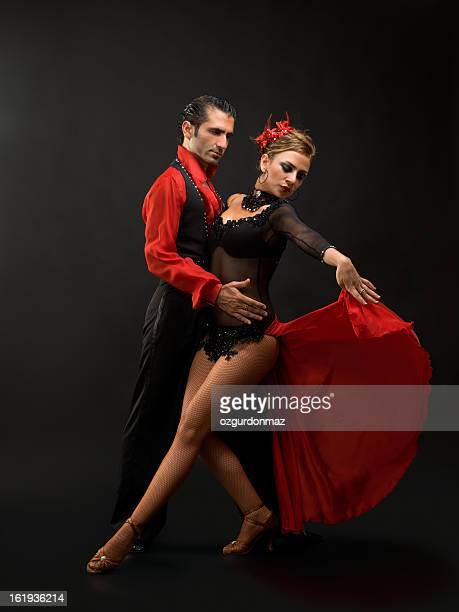 young couple dancing - tango dance stock photos and pictures