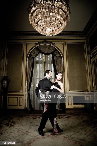 Young Couple Dancing Tango in Elegant Room