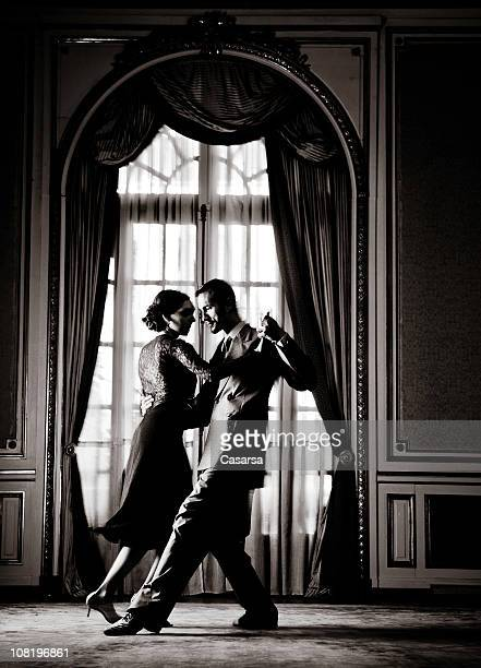 Young Couple Dancing Tango in Elegant Room, Toned