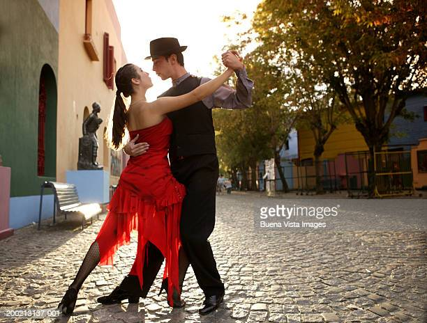 Young couple dancing Tango in street