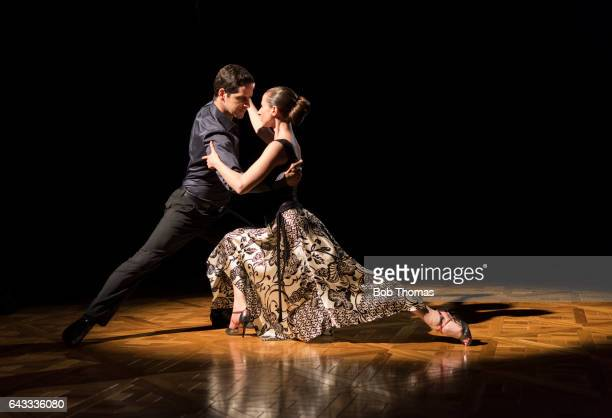 Young Couple Dancing The Tango Illuminated By Spotlight