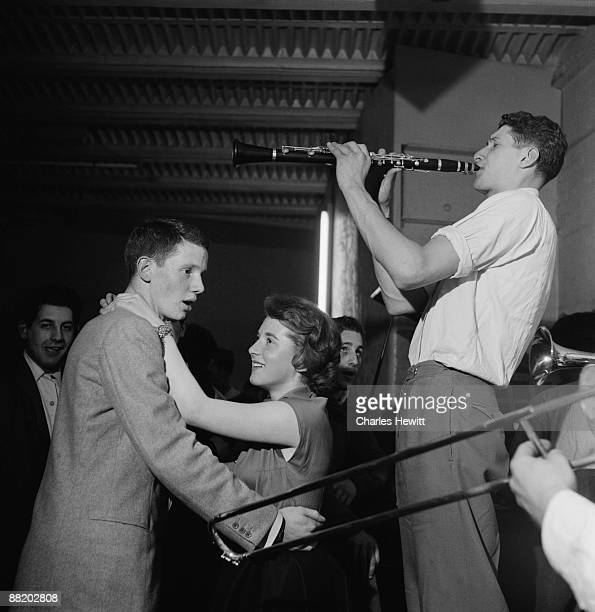 A young couple dancing to music to a band at Cy Laurie's Blue Heaven jazz club in Soho London 10th July 1954 Original publication Picture Post 7208...
