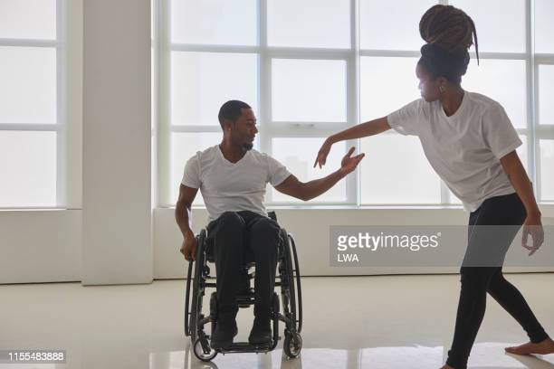 young couple dancing together - disabilitycollection stock-fotos und bilder