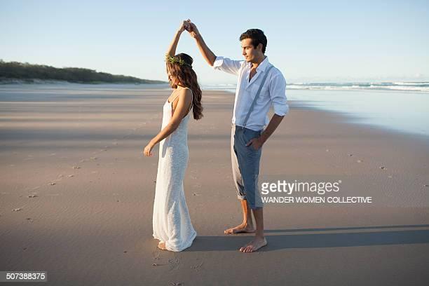 Young couple dancing wedding on beach