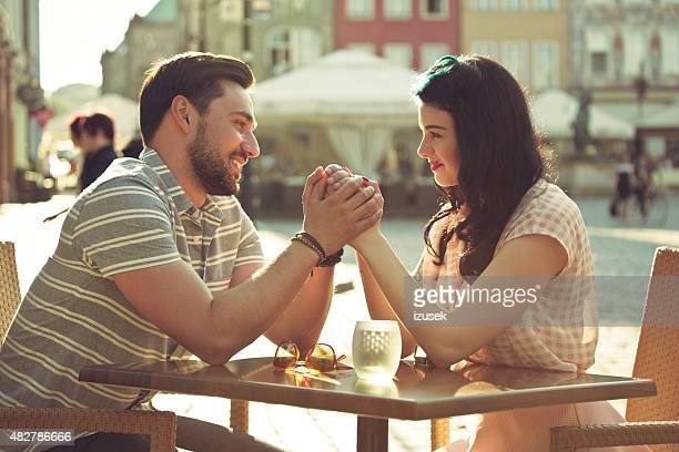 Young couple dating in the outdoor restaurant