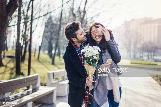 young couple dating on one sunny spring day - valentines day couple stock pictures, royalty-free photos & images