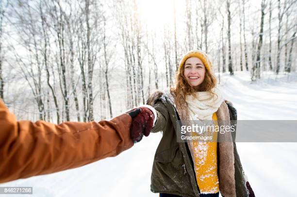 Young couple dating outside in winter.