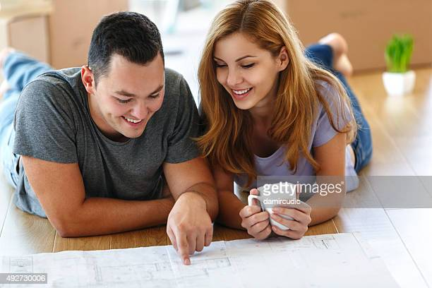 Young couple deciding where to put all their furniture