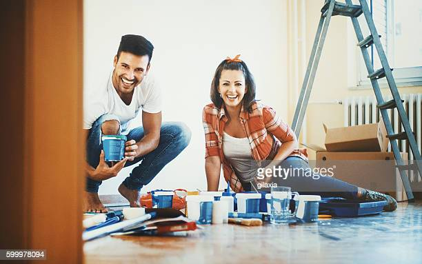 Young couple decorating apartment