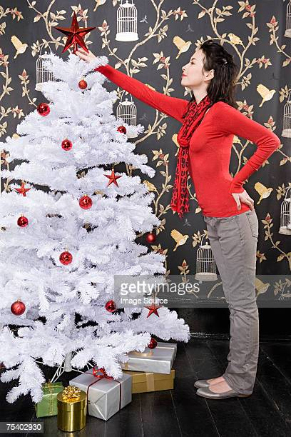 Young couple decorating christmas tree