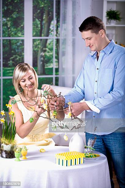 young couple decorating for easter - happy resurrection day stock pictures, royalty-free photos & images