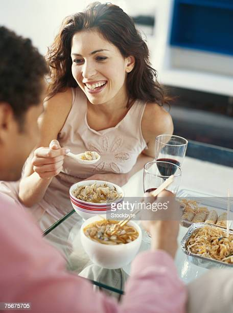 Young couple dining at restaurant