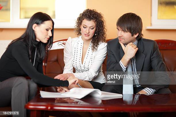 Young Couple Discussing Mortgage Loan