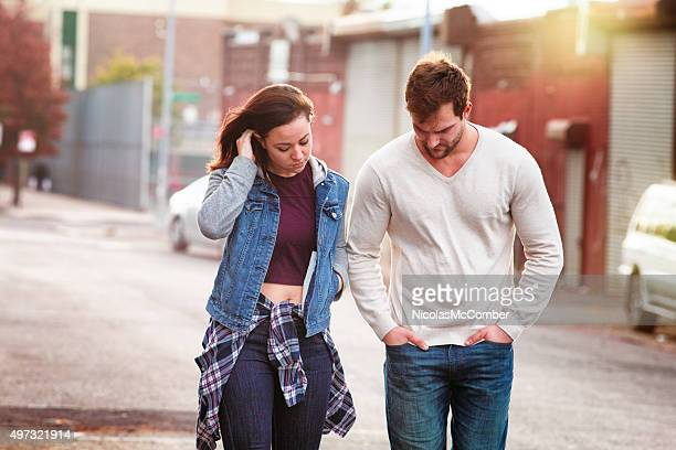 Young couple discussing relationship difficulties urban setting