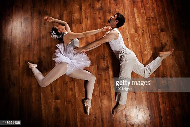 young couple doing ballet - legs spread woman stock photos and pictures