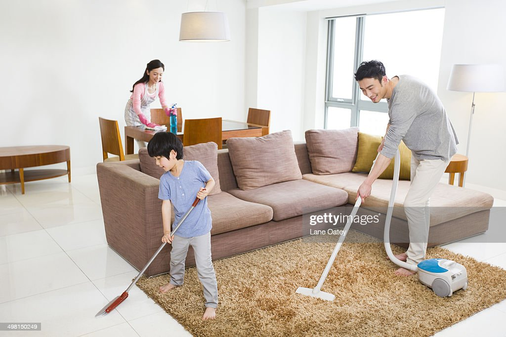 Young couple doing chores at home : Stock Photo