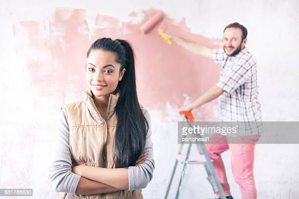 Young couple doing home improvement