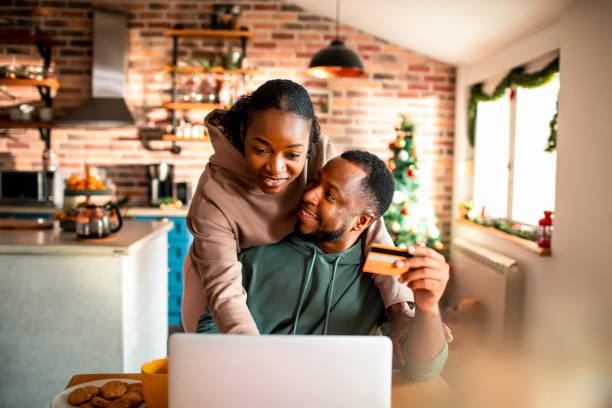 young couple doing online christmas shopping picture id1283427204?k=6&m=1283427204&s=612x612&w=0&h=KNu fN2qMQSayURcEMj7oXFftAEPXgpnHBqJqvd2yQ=