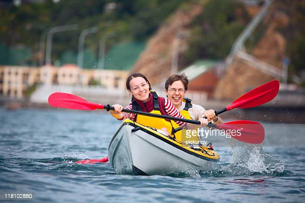 Young couple doing sea kayaking