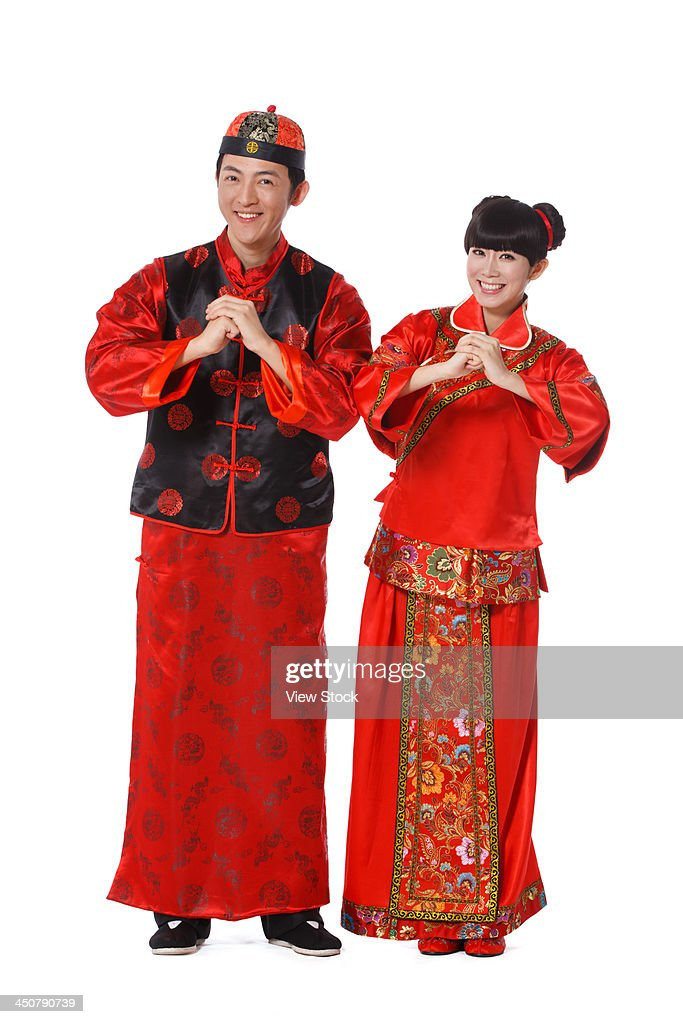 young couple dressed in chinese traditional clothes celebrating chinese new year stock photo. Black Bedroom Furniture Sets. Home Design Ideas