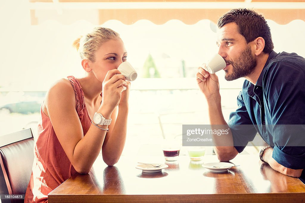 Young couple drink coffee at italian café : Stock Photo