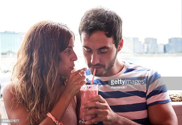 Young couple drinking a milkshake