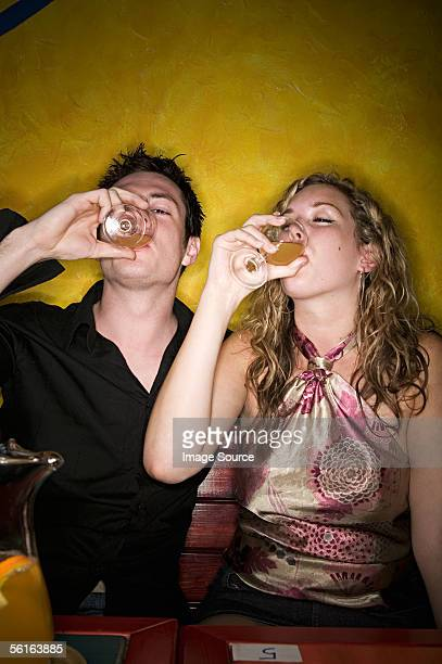 young couple drinking alcohol - 酔う ストックフォトと画像